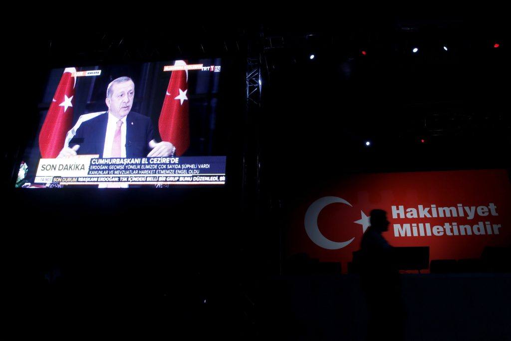 """Turkish President Tayyip Erdogan is displayed on a screen doing an interview, during a pro-government demonstration on Taksim square in Istanbul on Wednesday. The slogan reads, """"Sovereignty belongs to the nation.""""(Reuters/Alkis Konstantinidis)"""