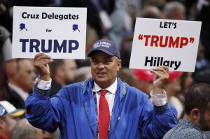 A delegate holds a sign calling for Cruz delegates to support Trump at the RNC on Wednesday.  (Reuters/Jim Young)