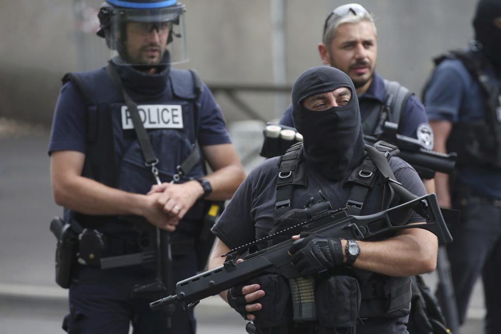 French police and anti-crime brigade (BAC) members secure a street as they carried out a counter-terrorism swoop at different locations in Argenteuil, a suburb north of Paris, France, July 21. (Charles Platiau/Reuters)