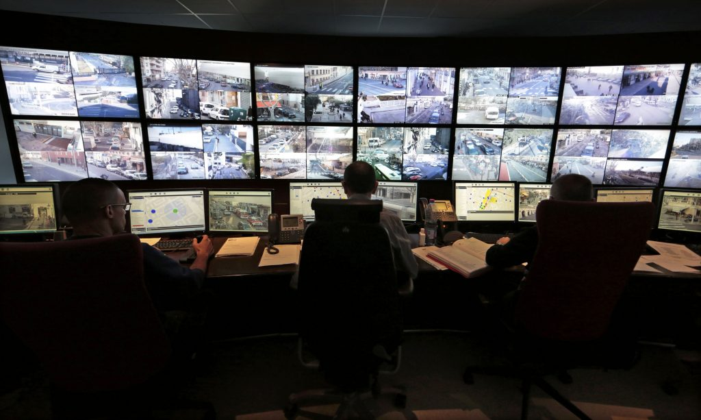 This photo, taken in February of 2015, shows French municipal police officers watching screens in the video surveillance control room of the municipal police supervision center in Nice. (Reuters/Eric Gaillard/File)