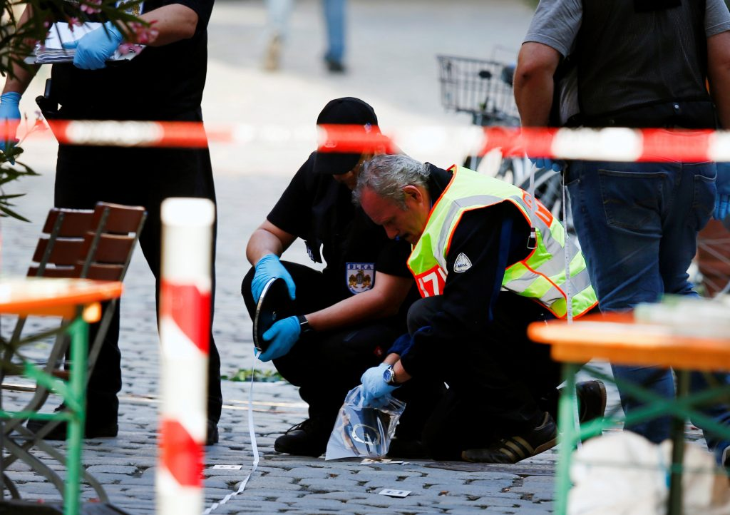 Police at the scene of the an explosion in Ansbach, Germany. (Reuters/Michaela Rehle)
