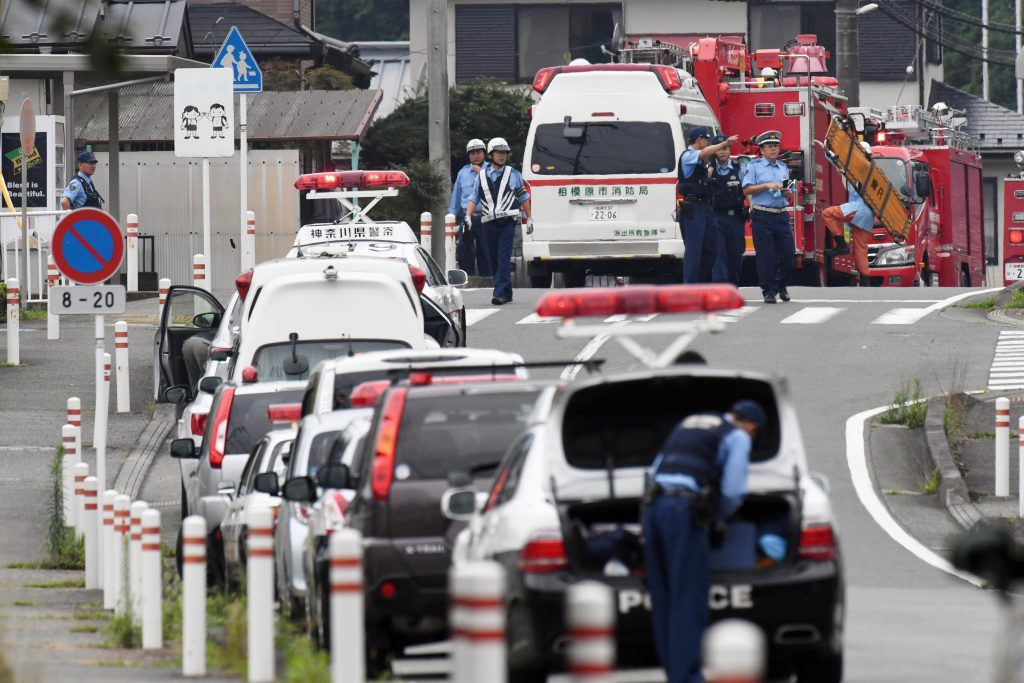 Police officers are seen near a facility for the disabled where at least 19 people were killed and as many as 20 wounded by a knife-wielding man, in Sagamihara, Kanagawa prefecture, Japan. Kyodo/Reuters).