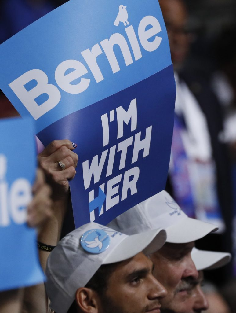 Supporters of former Democratic U.S. presidential candidate Bernie Sanders wave signs during his speech at the Democratic National Convention in Philadelphia, Pennsylvania. (Mike Segar/Reuters)