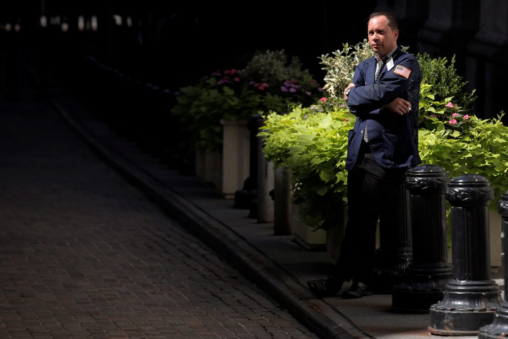 A trader takes a break outside the New York Stock Exchange on Wednesday. (Reuters/Brendan McDermid)