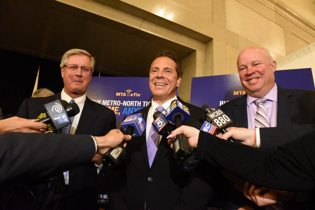 (L-R) Mark Heavey, MTA Director of Marketing and Communications; New York Gov. Andrew M. Cuomo; and Thomas F. Prendergast, Chairman and CEO of the MTA, at the press conference at Grand Central terminal, on Tuesday. (Office of Governor Andrew M. Cuomo/Don Pollard)
