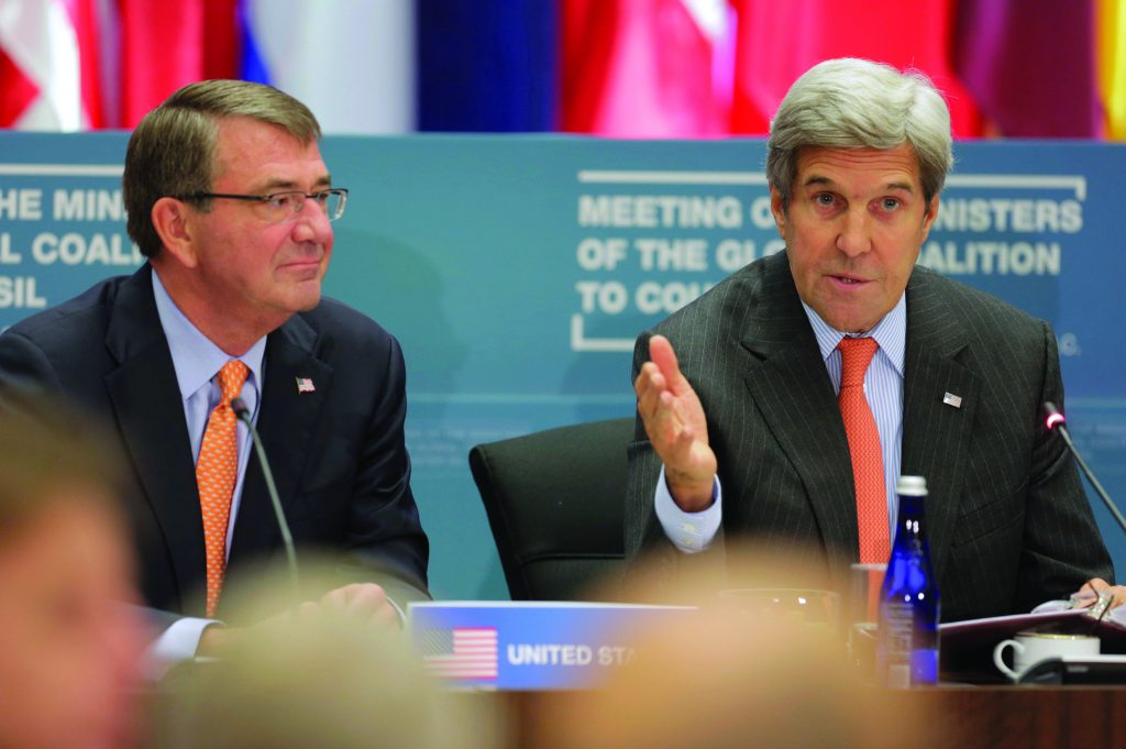 """U.S. Secretary of State JohnKerry(R) and U.S. Secretary of Defense Ash Carter speak at a """"Meeting of the Ministers of the Global Coalition to Counter ISIL: Joint Plenary Session"""" at the State Department in Washington, U.S., Thursday. (Joshua Roberts/Reuters)"""