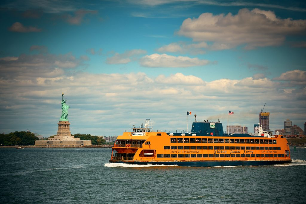 The Staten Island Ferry with the Statue of Liberty in the background, in New York Harbor.