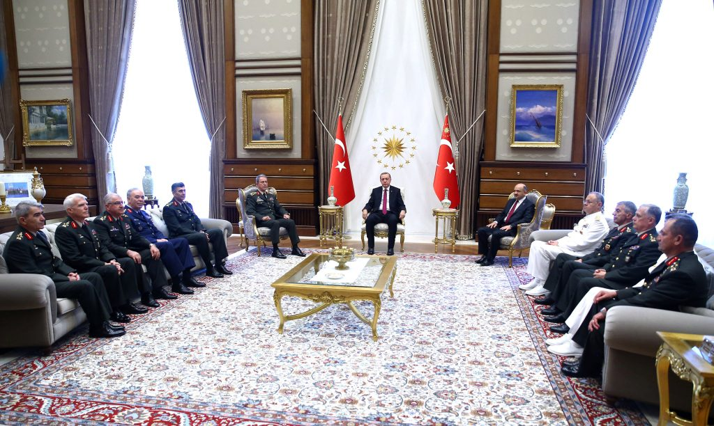 Turkey's President Tayyip Erdogan (C) meets with Turkey's Chief of Staff General Hulusi Akar (6th L), Defense Minister Fikri Isik (6th R) and the members of High Military Council at the Presidential Palace in Ankara, Turkey, July 29, 2016. Kayhan Ozer/Presidential Palace/Handout via REUTERS ATTENTION EDITORS - THIS PICTURE WAS PROVIDED BY A THIRD PARTY. FOR EDITORIAL USE ONLY. NO RESALES. NO ARCHIVE.