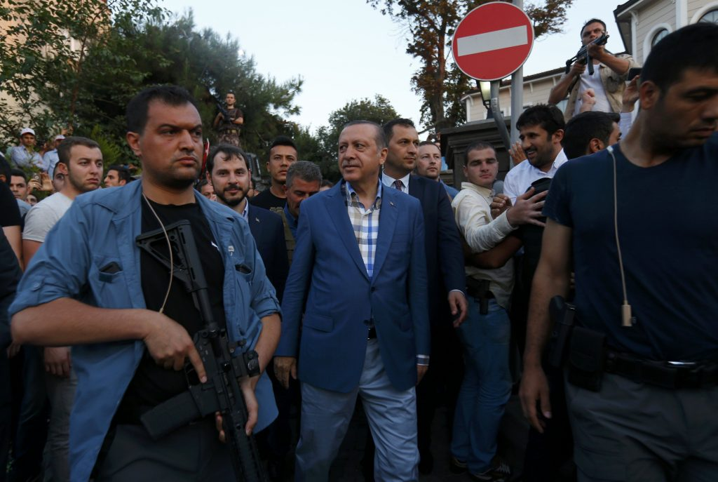 Turkish President Tayyip Erdogan walks through the crowd of supporters protected by bodyguards in Istanbul, Turkey, July 16, 2016. REUTERS/Murad Sezer