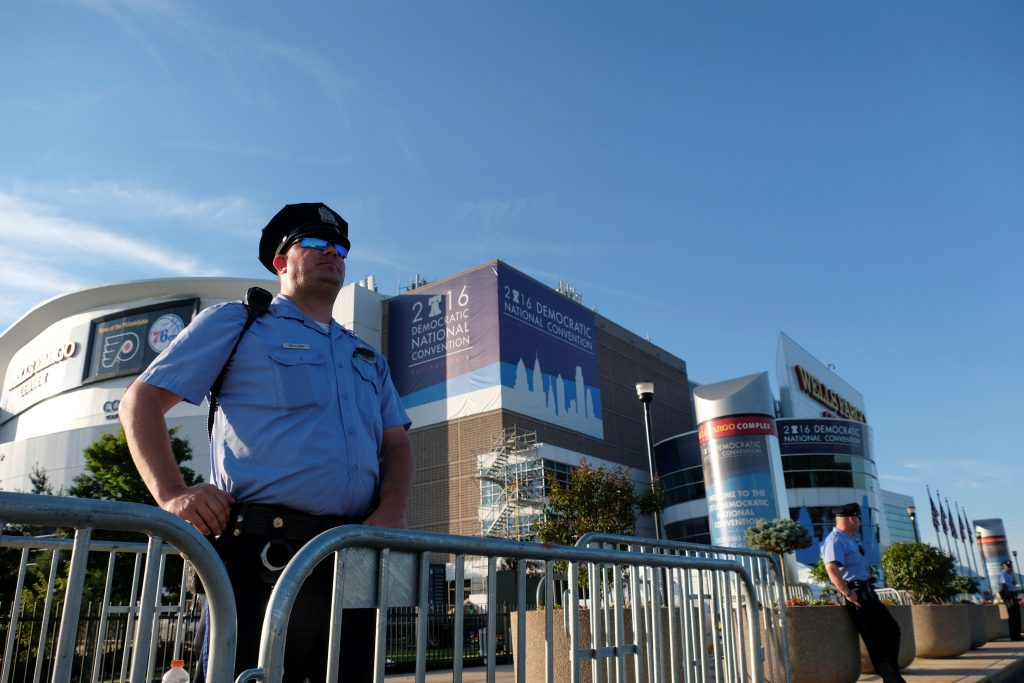 A police officer stands watch outside the Wells Fargo Center, site of the Democratic National Convention in Philadelphia, Pennsylvania, U.S., July 24, 2016. REUTERS/Bryan Woolston