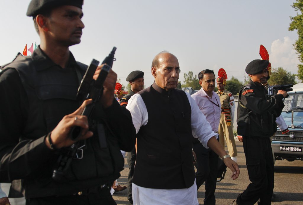 Indian Home Minister Rajnath Singh, center, arrives for a press conference in Srinagar, Indian-controlled Kashmir, on Sunday. (AP Photo/Mukhtar Khan)