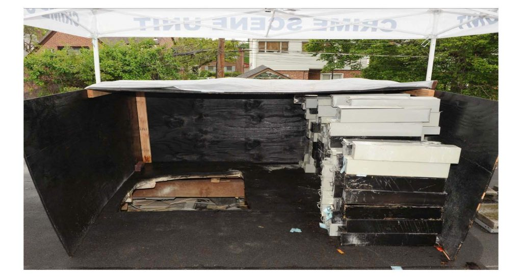 The empty safe deposit boxes in the plywood structure on the roof of the Maspeth bank. (U.S. Attorney's Office)