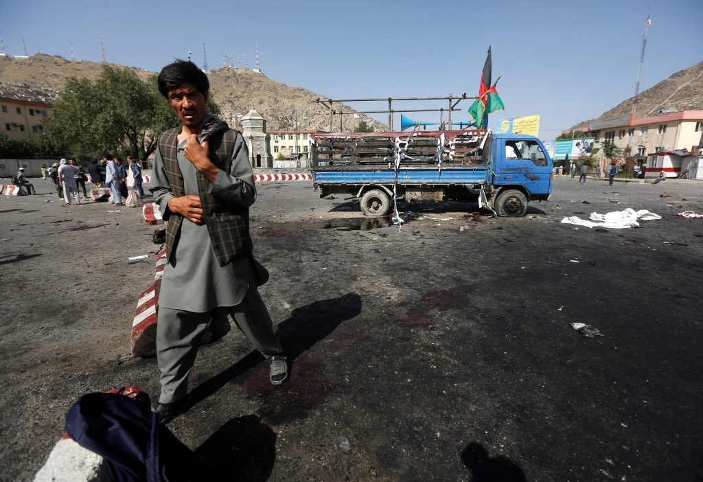 An Afghan man walks at the site of a suicide attack in Kabul, Afghanistan July 23, 2016. REUTERS/Omar Sobhani