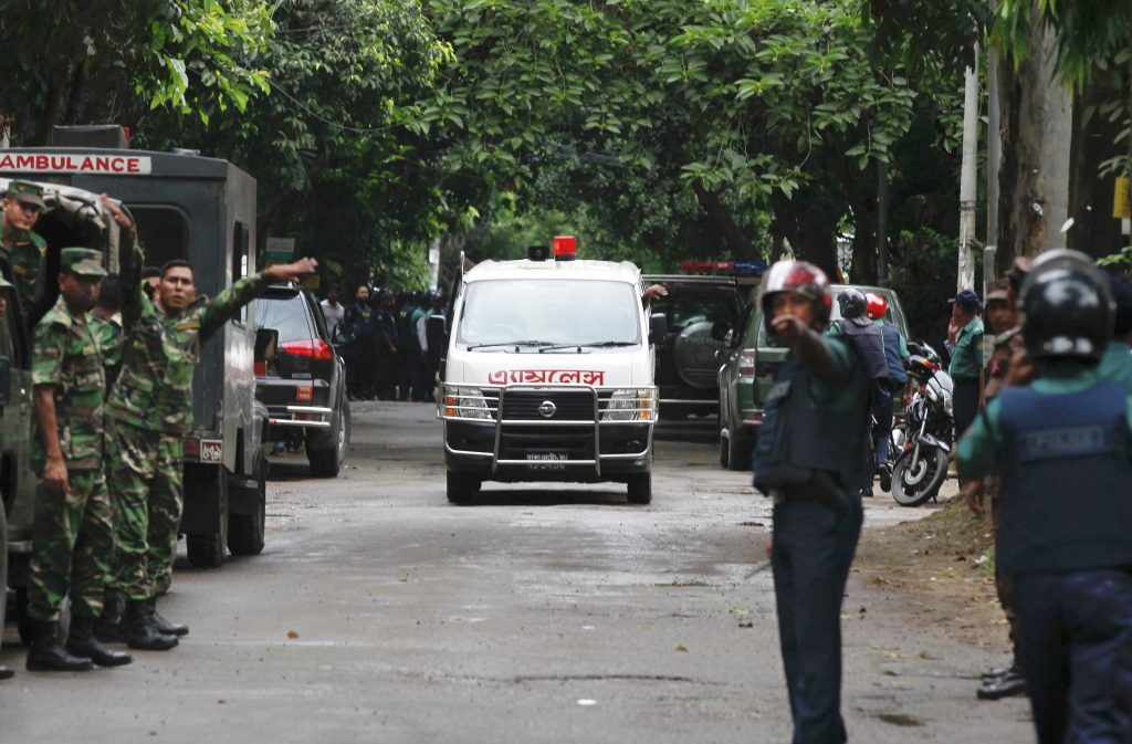 An ambulance transports bodies found at a restaurant popular with foreigners after heavily armed militants attacked it on Friday night in Dhaka, Bangladesh, Saturday, July 2, 2016. (AP Photo)
