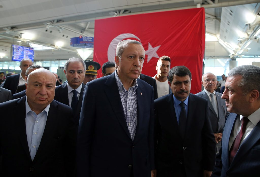Turkey's President Recep Tayyip Erdogan, center, visits Ataturk Airport in Istanbul, after Tuesday's blasts, Saturday July 2, 2016. Tuesday's gunfire and suicide bombing attack at Ataturk Airport killed dozens and injured over 200. Turkish authorities have banned distribution of images relating to the Ataturk airport attack within Turkey. (Kayhan Ozer, Presidential Press Service, Pool via AP)