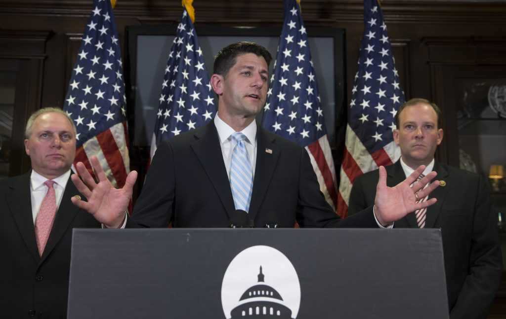 House Speaker Paul Ryan of Wis., flanked by House Majority Whip Steve Scalise of La., left, and Rep. Lee Zeldin R-N.Y., right, tells reporters it looks like Hillary Clinton got preferential treatment from the FBI in its investigation of the former secretary of state's use of a private email server for government business, during a news conference at Republican National Committee Headquarters on Capitol Hill in Washington, Wednesday, July 6, 2016. He said there are a number of outstanding questions about the FBI inquiry. Director James Comey will be testifying Thursday before the House Oversight committee, and the House Judiciary panel has scheduled a hearing next week with Attorney General Loretta Lynch. (AP Photo/J. Scott Applewhite)
