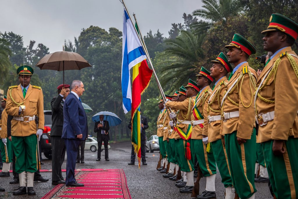 Israeli Prime Minister Benjamin Netanyahu, center, inspects the guard of honour outside the Ethiopian National Palace in Addis Ababa, Ethiopia, Thursday, July 7, 2016. Netanyahu is on one day state visit to Ethiopia. (AP Photo/Mulugeta Ayene)