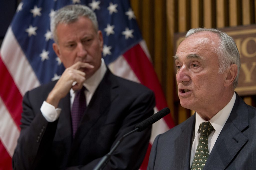 New York City Police Commissioner William Bratton, right, is joined by Mayor Bill de Blasio during a news conference earlier this month. (AP Photo/Mary Altaffer)