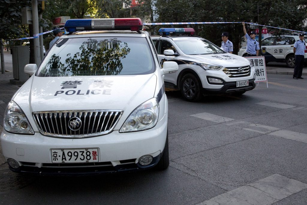 Chinese police vehicles close off a road leading to the Philippines embassy in Beijing. (AP Photo/Ng Han Guan)
