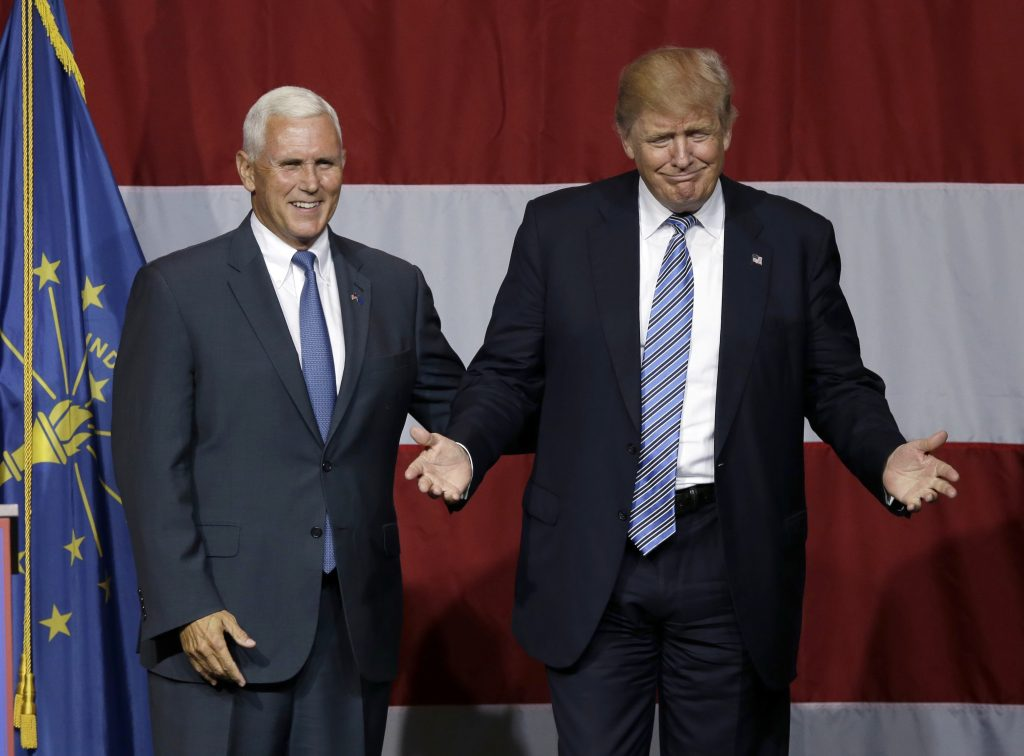 FILE - In this July 12, 2016 file photo, Indiana Gov. Mike Pence joins Republican presidential candidate Donald Trump at a rally in Westfield, Ind. (AP Photo/Michael Conroy, File)
