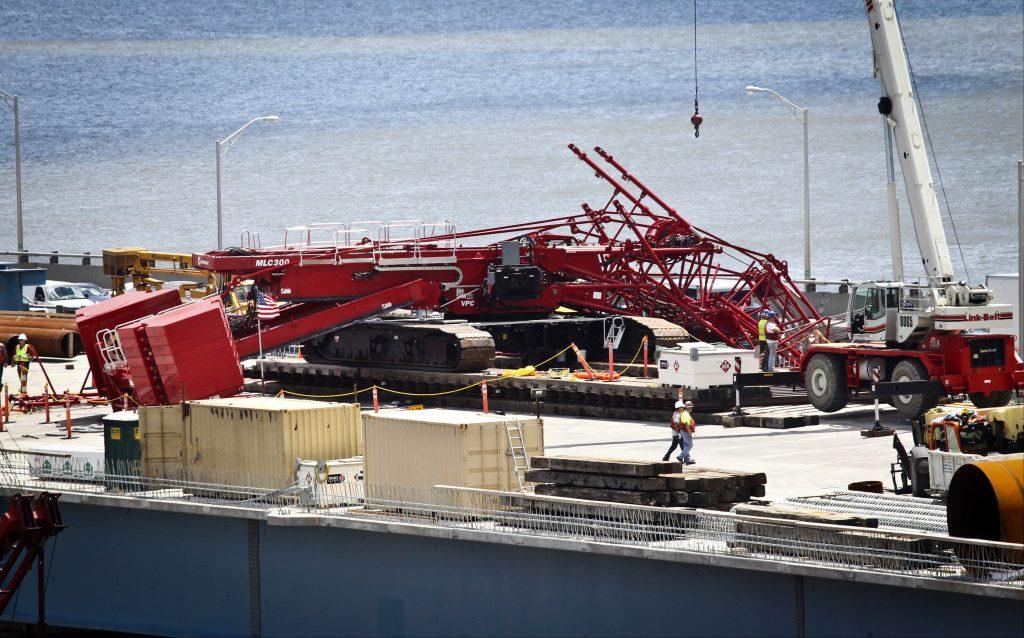 A construction crane is sprawled across the Tappan Zee Bridge on Tuesday. (Peter Carr/The Journal News via AP)