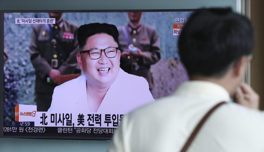"A man walks by a screen showing the North Korean leader Kim Jong Un at the Seoul Train Station in Seoul, South Korea, Wednesday, July 20, 2016. North Korea said Wednesday it test-fired ballistic rockets as part of a simulated pre-emptive attack on ports and airfields in South Korea, in a likely reference to the three missile launches that Seoul says the North carried out a day earlier. The letters, the top left, read: ""North Korea, Missile pre-emptive attack drill."" (AP Photo/Lee Jin-man)"