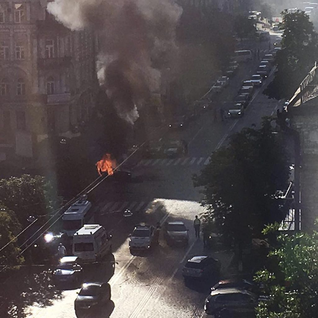 In this photo provided by Vlad Ivanenko, a car burns after an explosion in Kiev, Ukraine, Wednesday, July 20, 2016. Pavel Sheremet, 44-year old Belarusian-born prominent journalist was killed in a car bombing in Ukraine's capital, Kiev, Wednesday. (Vlad Ivanenko via AP)