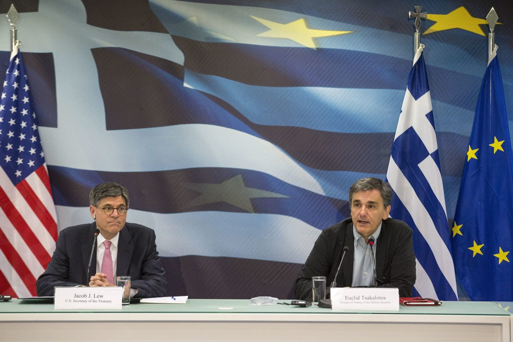 United States Secretary of the Treasury Jacob Lew, left, and Greek finance Minister Euclid Tsakalotos address journalists during a news conference in Athens, Thursday, July 21, 2016. Lew met with Greece's finance minister during a visit to discuss the country's progress in meeting reforms required under its third international bailout. (AP Photo/Yorgos Karahalis)