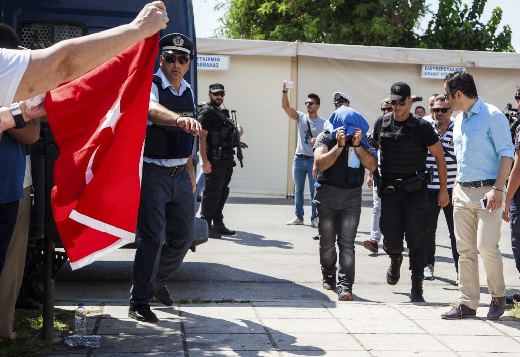 A Turkish military officer is transferred to a court hall in the city of Alexandroupolis, northern Greece, Thursday, July 21. (Antonis Pasvantis/InTime News via AP)
