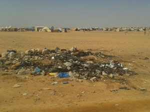 Trash bakes in the sun from 64,000 Syrian refugees stranded in the Ruqban border camp in northeast Jordan. (AP Photo)