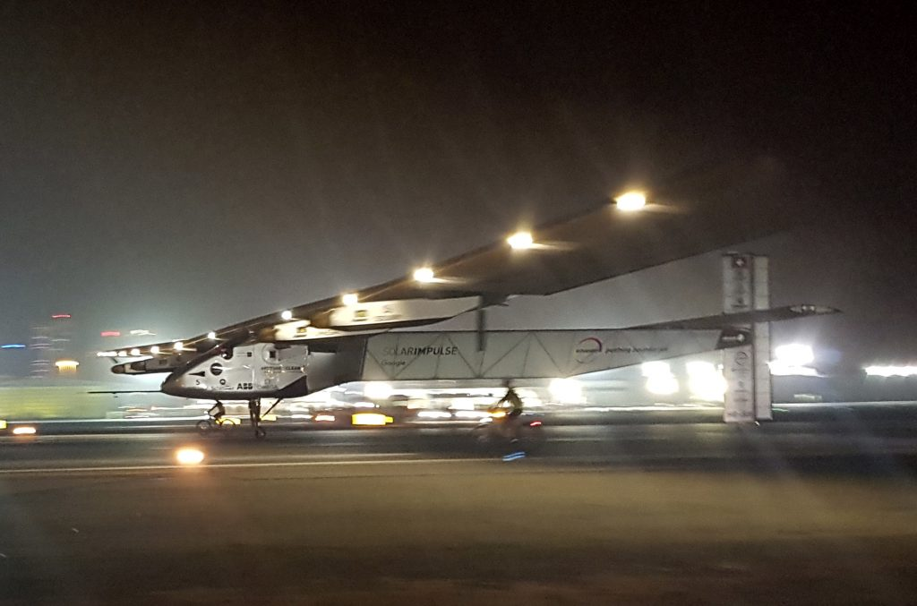 The Solar Impulse 2 plane lands in an airport in Abu Dhabi, United Arab Emirates, early Tuesday, July 26. (AP Photo/Aya Batrawy)