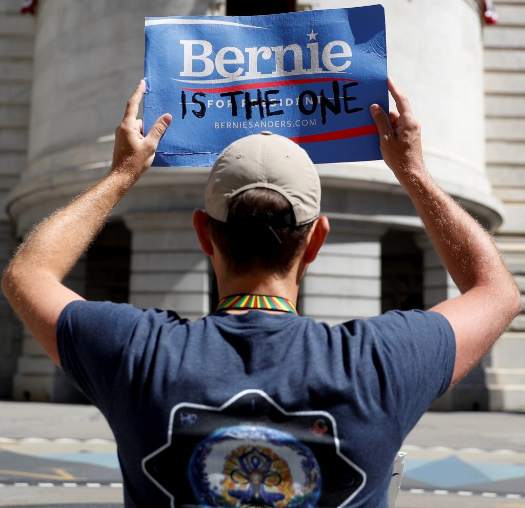 A supporter of Bernie Sanders holds up a protest sign in Philadelphia on Tuesday. (AP Photo/John Minchillo)