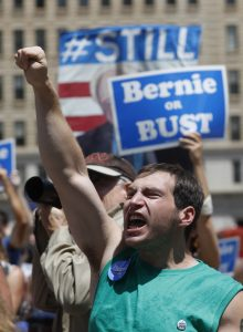 Bernie Sanders supporters at a protest Tuesday. (AP Photo/John Minchillo)