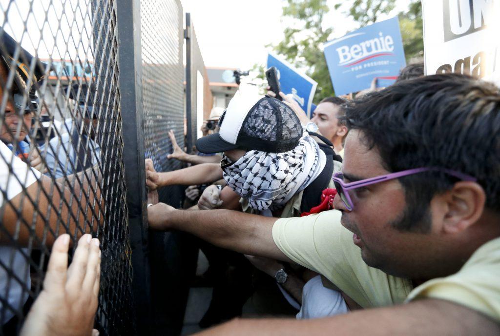 Demonstrators clash near the Democratic National Convention on Tuesday. (AP Photo/Alex Brandon)
