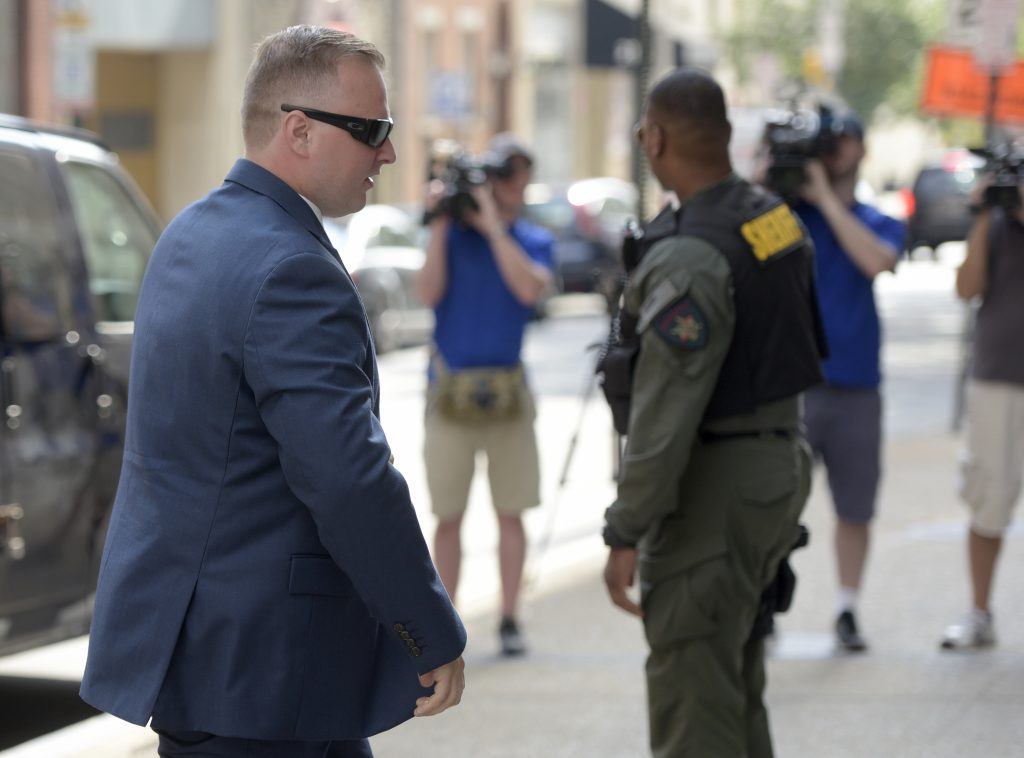 Officer Garrett Miller, one of the six members of the Baltimore Police Department charged in connection to the death of Freddie Gray, arrives at a courthouse for his pre-trial proceedings in Baltimore, Wednesday, July 27, 2016. (AP Photo/Steve Ruark)