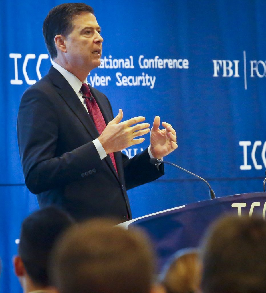 James Comey, director of the Federal Bureau of Investigation, speaks as he delivers the keynote address at the International Conference on Cyber Security, Wednesday, July 27, 2016, at Fordham University in New York. (AP Photo/Bebeto Matthews)