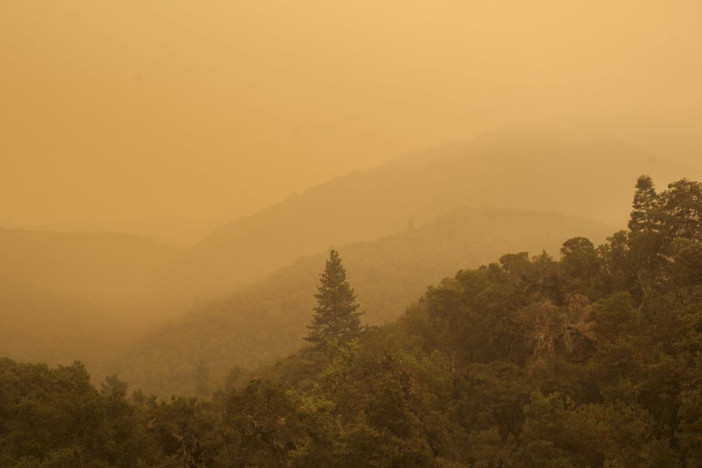 Smoke from a wildfire spreads over woods, as seen from White Rock in Carmel Valley, southeast of Monterey, Calif., Wednesday, July 27, 2016. Acting Gov. Tom Torlakson, substituting for Gov. Jerry Brown who is at the Democratic National Convention with other top state officials, declared a state of emergency for the fire and another wildfire outside of Los Angeles on Tuesday night. The move frees up funding and relaxes regulations to help with the firefight and recovery. (AP Photo/Nic Coury)