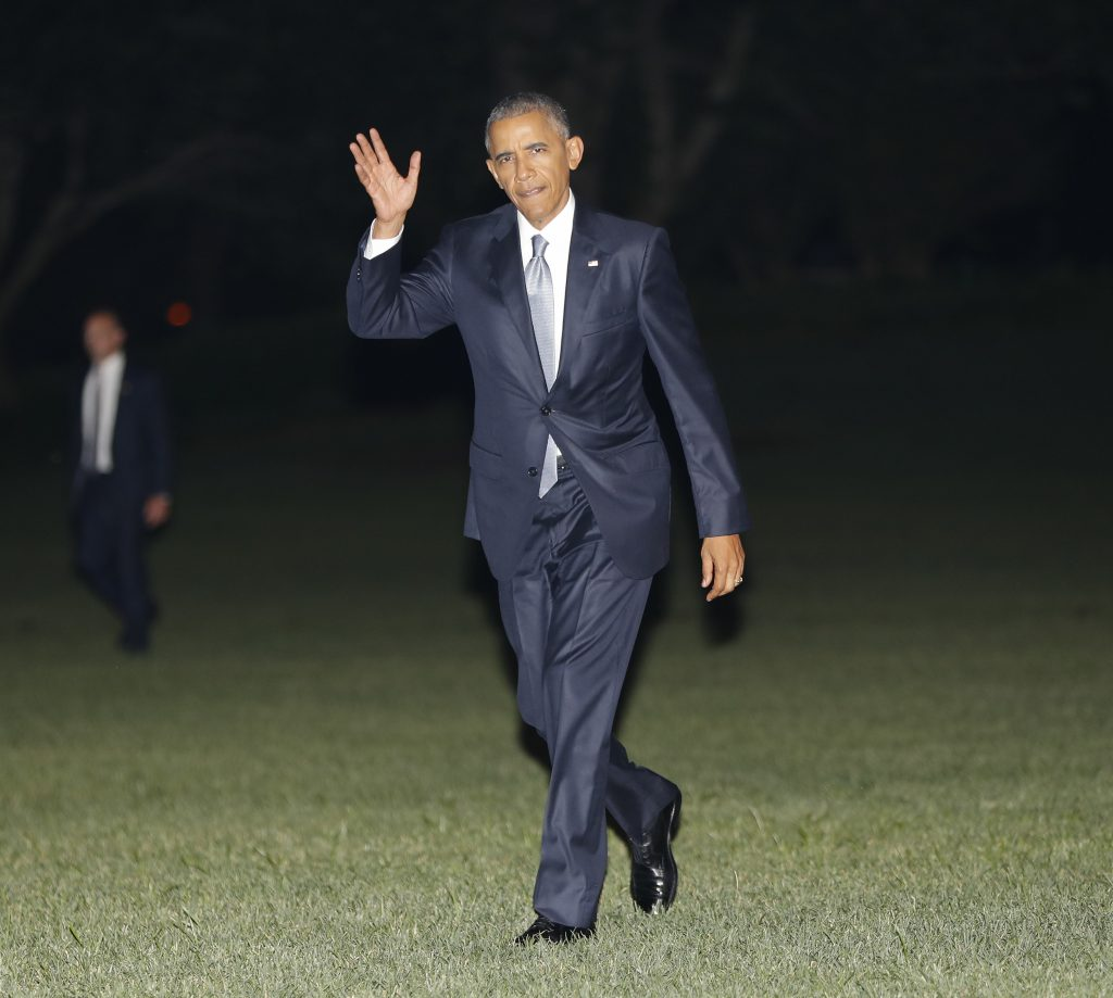 President Barack Obama waves as he walks across the South Lawn of the White House in Washington, Thursday, July 28, 2016, during his return from nearby Andrews Air Force Base. Obama traveled to Philadelphia and spoke at the 2016 Democratic National Convention. (AP Photo/Pablo Martinez Monsivais)