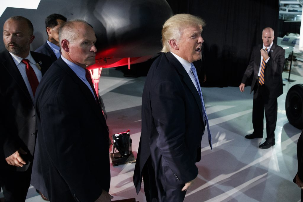 Republican presidential candidate Donald Trump walks off after speaking during a campaign rally at Wings Over the Rockies Air and Space Museum, Friday, July 29, 2016, in Denver. (AP Photo/Evan Vucci)
