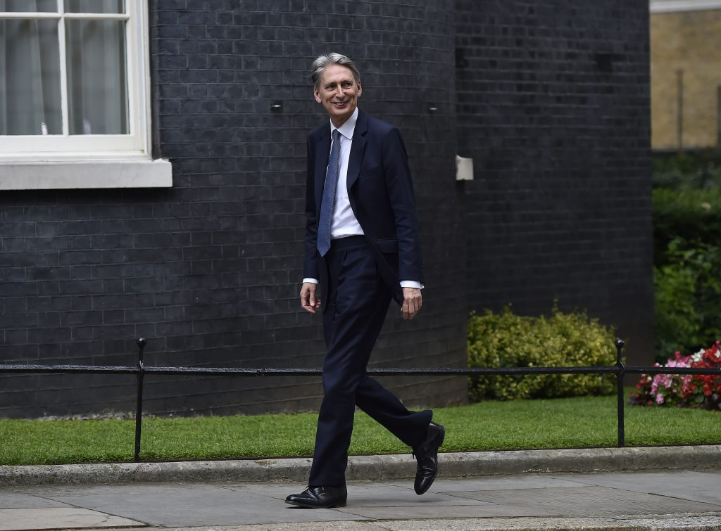Philip Hammond arrives at 10 Downing Street to meet with new Prime Minister Theresa May, in London, Wednesday, July 13, 2016. Hammond has been appointed Chancellor in Theresa May's first cabinet appointment. (Hannah McKay/PA via AP)