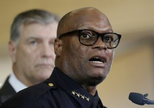 Dallas police chief David Brown, front, and Dallas mayor Mike Rawlings, rear, at a news conference on Friday. (AP Photo/Eric Gay)
