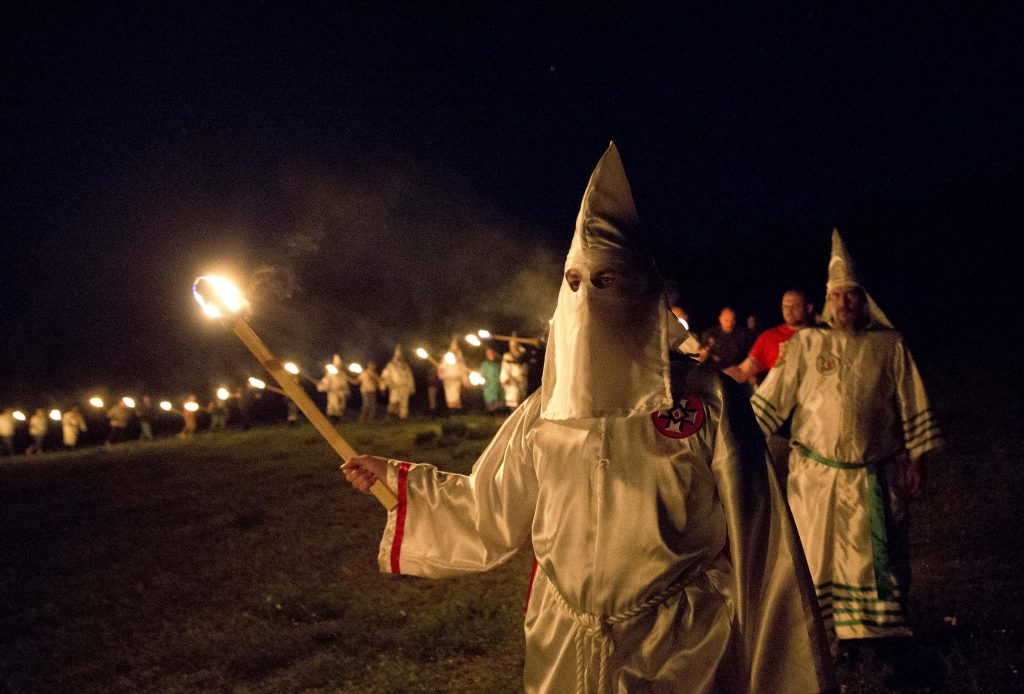 "A Ku Klux Klan ceremony after a ""white pride"" rally in Paulding County near Cedar Town, Ga., in April. (AP Photo/John Bazemore)"