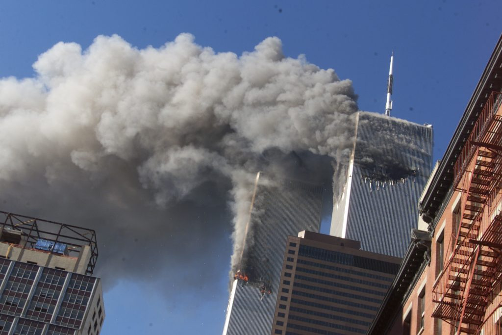 Smoke rises from the burning twin towers of the World Trade Center on Sept. 11, 2001. (AP Photo/Richard Drew)