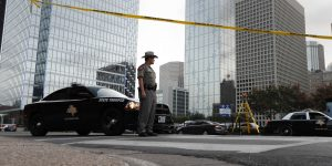 A Texas state trooper stands at a roadblock in Dallas on Monday, near the area where officials continue to investigate the fatal shooting of police officers at a Black Lives matter protest on Thursday night. (AP Photo/Eric Gay)
