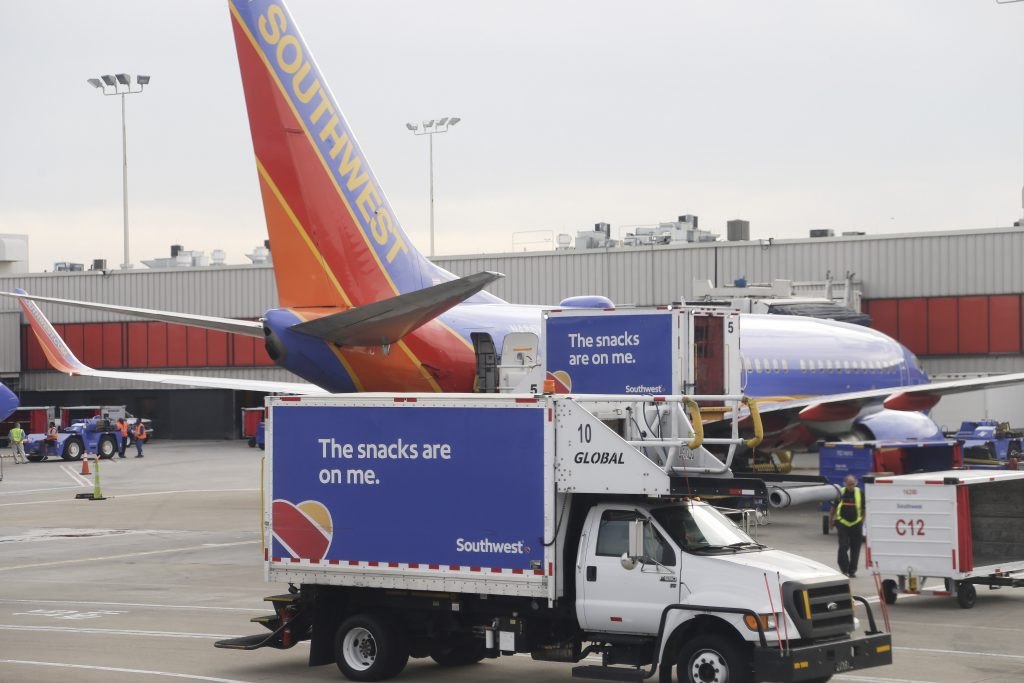 A Southwest airline sits at the gate at Hartsfield–Jackson Atlanta International Airport. (AP Photo/Mike Stewart)