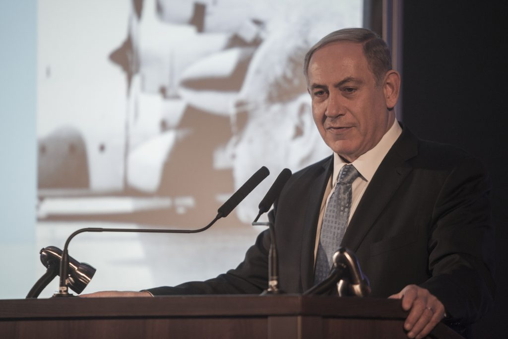 FILE - Israeli Prime Minister Binyamin Netanyahu speaks during the opening of an exhibition showcasing the 1976 Israeli commando rescue raid that freed hostages from a hijacked plane at Entebbe, Uganda. (AP Photo/Dan Balilty/FILE)