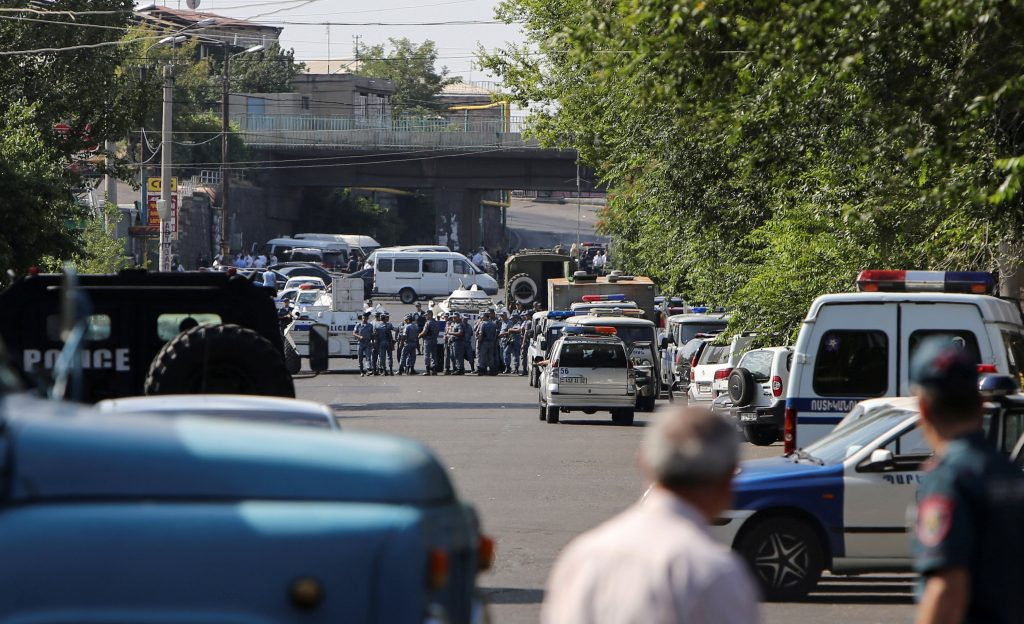 Policemen block a street after group of armed men seized a police station along with an unknown number of hostages, according the country's security service, in Yerevan, Armenia, July 17, 2016. REUTERS/Vahram Baghdasaryan/Photolure EDITORIAL USE ONLY. NO RESALES. NO ARCHIVE TPX IMAGES OF THE DAY