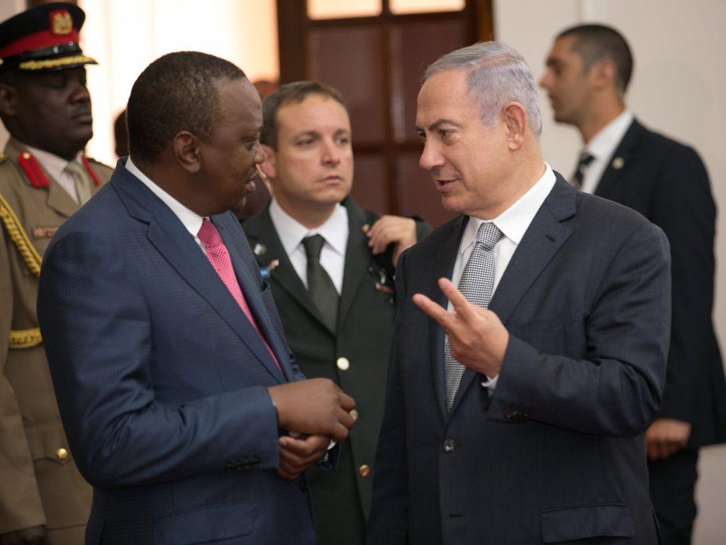 Kenya's President Uhuru Kenyatta (L) listens to Israeli Prime Minister Binyamin Netanyahu (R) during an offical reception at the State House in Nairobi, Tuesday. (Presidential Press Service/Handout via Reuters)