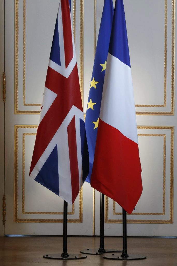 Britain, European and French flags are seen before a news conference at the Elysee Palace in Paris, France, July 21, 2016. REUTERS/Philippe Wojazer