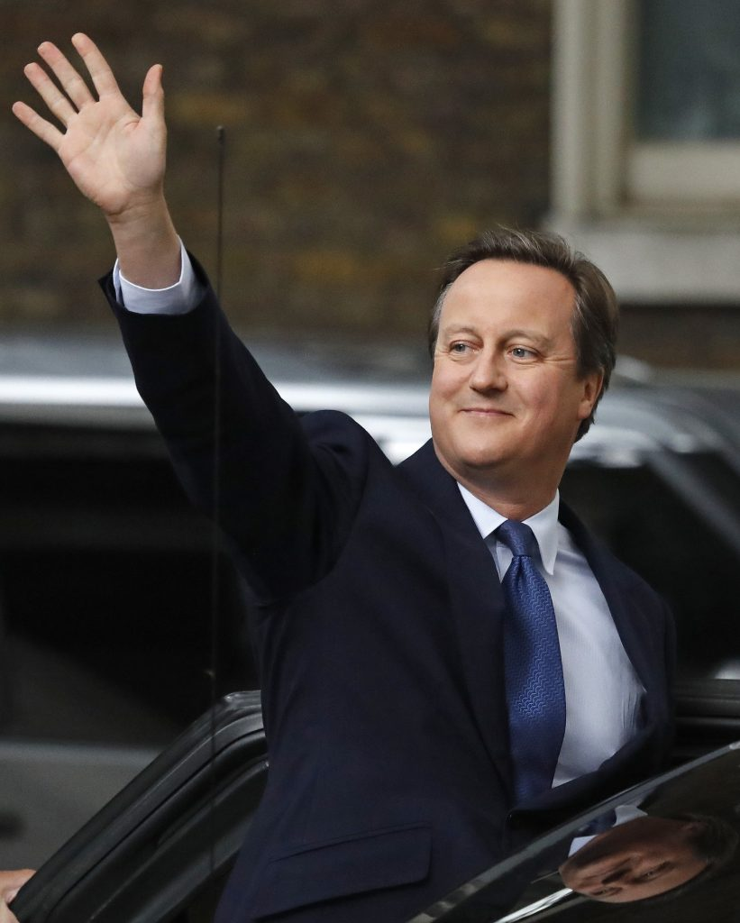 Britain's Prime Minister David Cameron waves as he leaves 10 Downing Street, in London, Wednesday, July 13, 2016. Cameron will formally resign during a meeting with Queen Elizabeth II at Buckingham Palace, then Theresa May, the Home Secretary, will take over. (AP Photo/Frank Augstein)